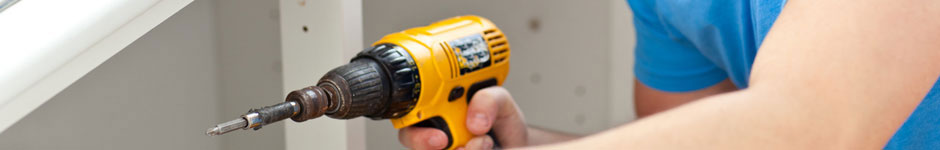 Person holding power drill