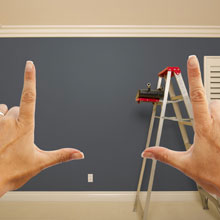 Hands framing wall to visualize wall space