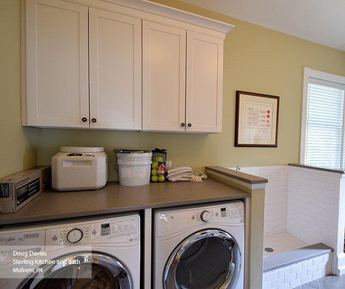 Laundry room with white wall cabinets in the Brellin laminate door style