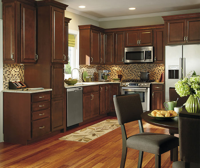 Dark wood kitchen cabinets by Aristokraft Cabinetry