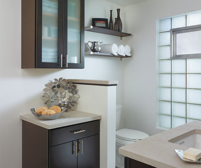 Dark wood cabinet in contemporary bathroom