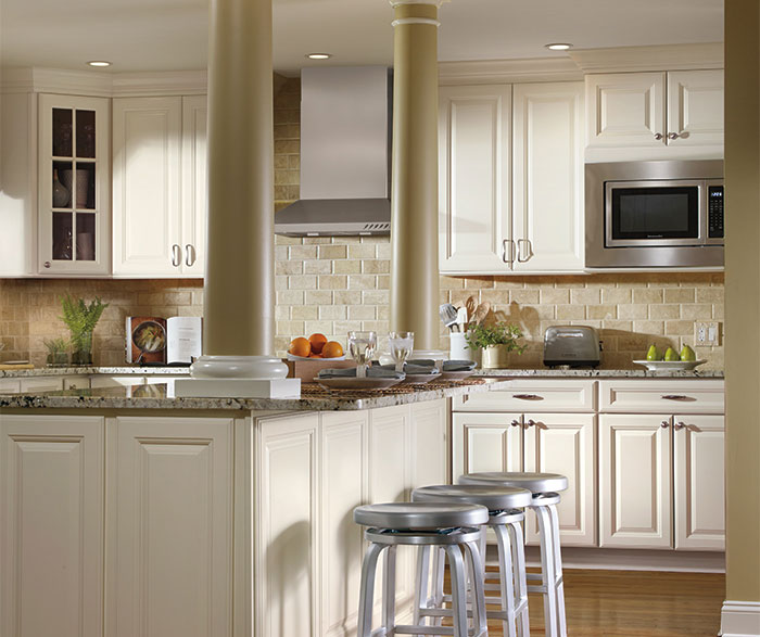 Ivory cabinets in traditional kitchen by Aristokraft Cabinetry