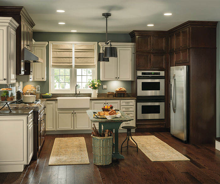 Rustic kitchen with contrasting finishes by Aristokraft Cabinetry