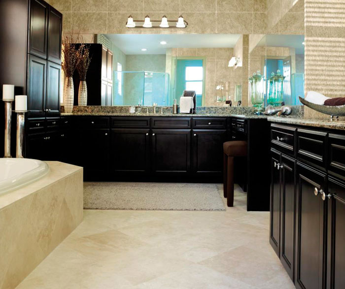 Sarsaparilla cabinets in traditional bathroom by Aristokraft Cabinetry
